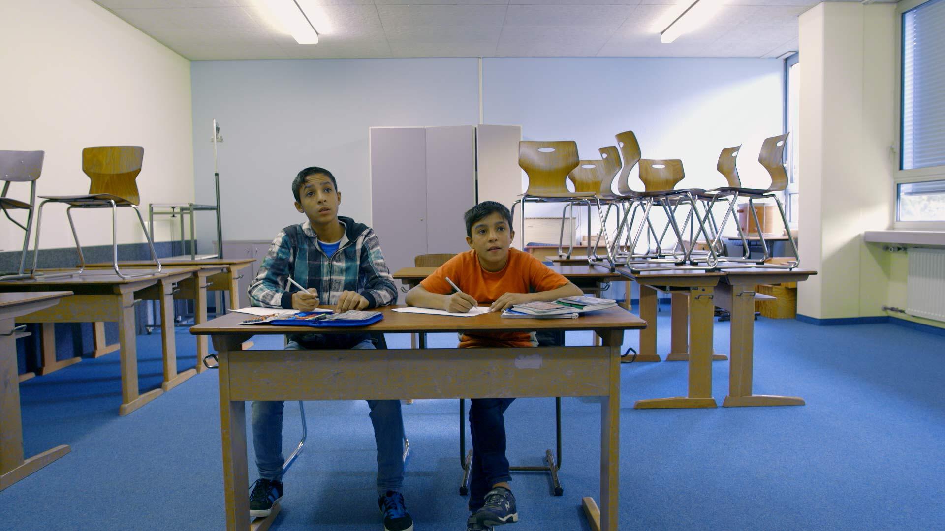 junge Syrer in der Schule