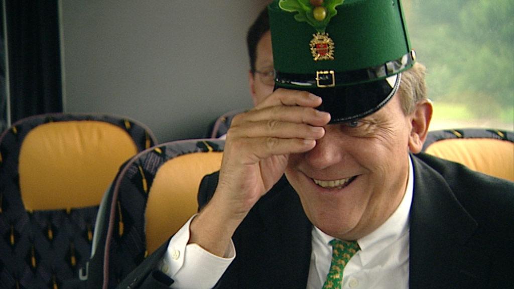 Michael Spreng trägt eine grüne Mütze